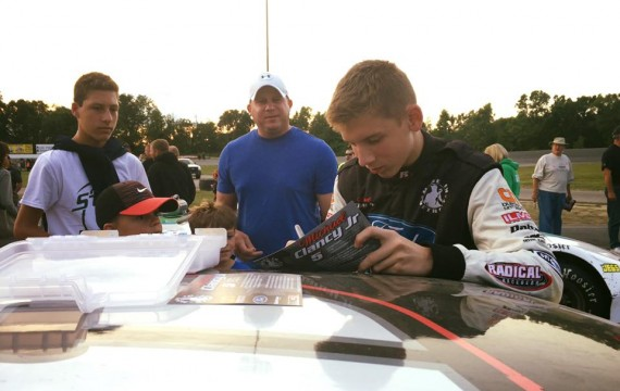Michael Signing Autographs at Auto City